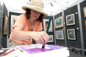Painting at the LowerTown Art & Music Festival (photo credit: The Paducah Sun)
