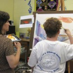 A client adds her touches to the painting