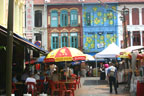 Colorful crowded streets of Chinatown in Singapore