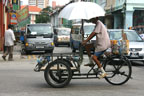 A bicycle rickshaw -- not one of our transportations