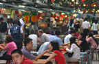A tender moment in a crowded Singapore foodcourt