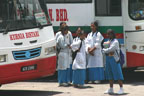 Schoolgirls waiting at the bus station in Tanah Rata
